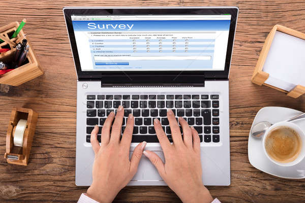 6jjj8095135 stock photo businesswoman doing survey on laptop